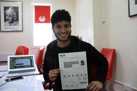 A boy with IELTS application form for IELTS training in Kuwait